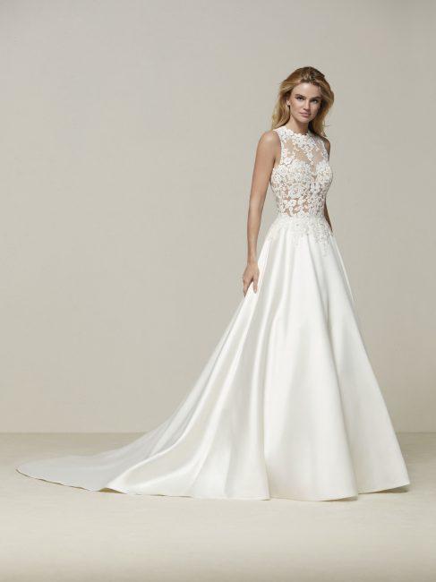 Drusena è un esempio di abito da sposa A-Line con il corpetto aderente in  tulle ricamato e la gonna in mikado dalla tipica forma ad A. a99dd8c79c5