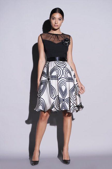 5e6b3746a827 Vestitito black white da cerimonia con top liscio abbinato ad una magnifica  gonna a balze in organza con cinturina e decoro centrale