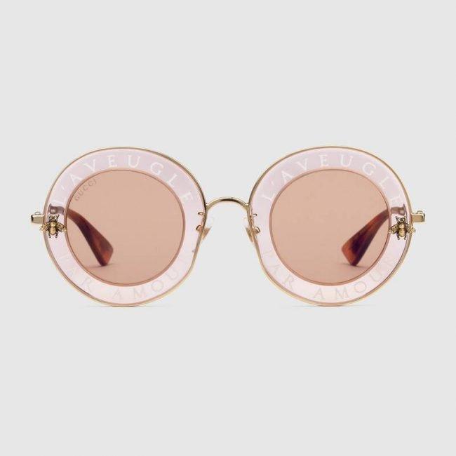 Occhiali da sole rotondi GUCCI con scritta collezione 2019