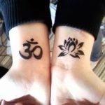 Tatuaggi OM con Fior di Loto
